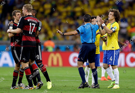Referee Marco Rodriguez from Mexico breaks up an argument between Germany's Thomas Mueller, far left, and Brazil's David Luiz (4) during the World Cup semifinal soccer match between Brazil and Germany at the Mineirao Stadium in Belo Horizonte, Brazil