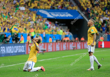 Stock Image of Brazil's Neymar celebrates with Benoit Assou-Ekotto, right, after scoring his side's second goal during the group A World Cup soccer match between Cameroon and Brazil at the Estadio Nacional in Brasilia, Brazil