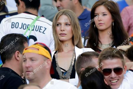 Sarah Brandner, the girlfriend of Germany's Bastian Schweinsteiger, waits for the start of the World Cup final soccer match between Germany and Argentina at the Maracana Stadium in Rio de Janeiro, Brazil