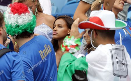 Fanny Neguesha, fiancee of Italy's Mario Balotelli, waits for the start of the group D World Cup soccer match between Italy and Uruguay at the Arena das Dunas in Natal, Brazil