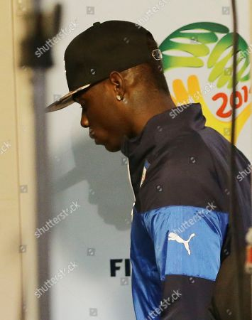 Italy forward Mario Balotelli walks away after the group D World Cup soccer match between Italy and Uruguay at the Arena das Dunas in Natal, Brazil, . Uruguay won 1-0. Uruguay won 1-0. The four-time champion Italy is heading home after the group phase for a second time in four years. Head coach Cesare Prandelli and football federation president Giancarlo Abete both resigned moments after the match