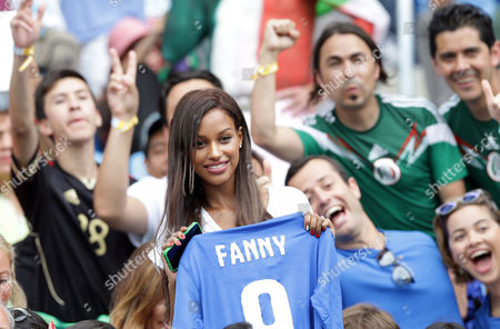 Fanny Neguesha, fiancee of Italy's Mario Balotelli, cheers prior to during the group D World Cup soccer match between Italy and Uruguay at the Arena das Dunas in Natal, Brazil