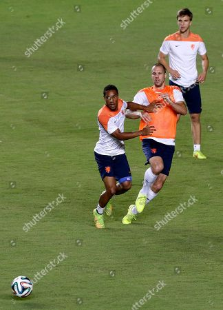 Jonathan de Guzman, Ron Vlaar, Paul Verhaegh Netherlands' Jonathan de Guzman, left, and Ron Vlaar, center, and Paul Verhaegh, right, watch the ball during their training session at the Roberto Santos stadium on in Salvador, Brazil. Netherlands play their quarterfinal match of the 2014 World Cup soccer tournament against Costa Rica on July 5 in Salvador