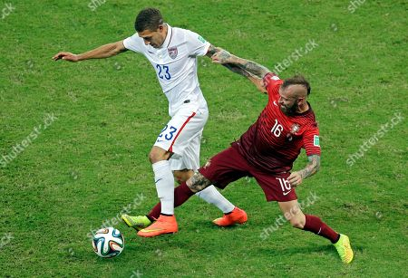 United States' Fabian Johnson, left, is challenged by Portugal's Raul Meireles during the group G World Cup soccer match between the USA and Portugal at the Arena da Amazonia in Manaus, Brazil