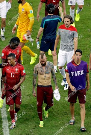 Portugal's Nani, Raul Meireles, and Andre Almeida, from left, leave the pitch after drawing 2-2 in the group G World Cup soccer match between the USA and Portugal at the Arena da Amazonia in Manaus, Brazil