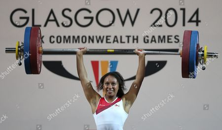 Zoe Smith of England makes her final lift to win the gold medal in the women's 58 kg weightlifting competition the Commonwealth Games Glasgow 2014, in Glasgow, Scotland, Saturday, July, 26, 2014
