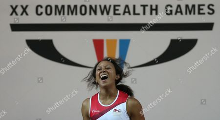 Zoe Smith of England leaps for joy as she wins the gold medal in the women's 58 kg weightlifting competition the Commonwealth Games Glasgow 2014, in Glasgow, Scotland, Saturday, July, 26, 2014