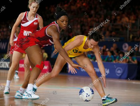 Eboni Beckford-Chambers, of England, right attempts to reach the ball from Natalie Medhurst of Australia during a preliminary round netball match at the Commonwealth Games Glasgow 2014, in Glasgow, Scotland, Saturday, July, 26, 2014. Australia won the match 49-48
