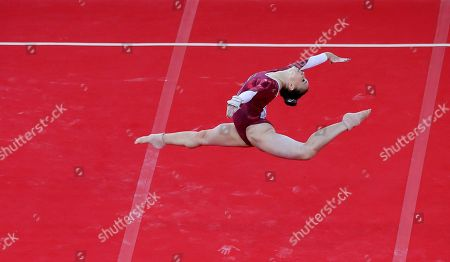Hannah Whelan of England performs her routine on the floor during the women's individual all-round gymnastic competition at the Commonwealth Games Glasgow 2014, in Glasgow, Scotland, Wednesday, July, 30, 2014