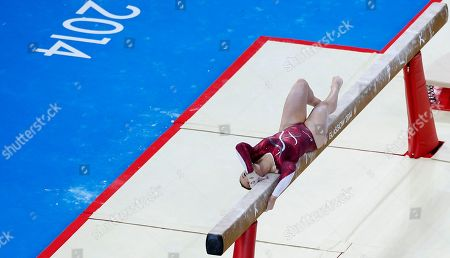 Hannah Whelan of England performs her routine on the beam during the women's individual all-round gymnastic competition at the Commonwealth Games Glasgow 2014, in Glasgow, Scotland, Wednesday, July, 30, 2014