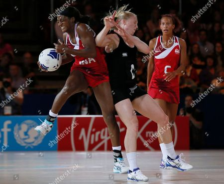 Stock Photo of Sasha Corbin, left of England, shields the ball from Laura Longman of New Zealand during their women's netball semifinal match at the Commonwealth Games Glasgow 2014, in Glasgow, Scotland
