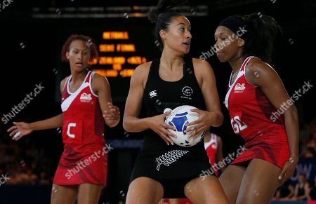 Maria Tuaia of New Zealand, centre, is blocked by Eboni Beckford- Chambers, right during their women's netball semifinal match at the Commonwealth Games Glasgow 2014, in Glasgow, Scotland