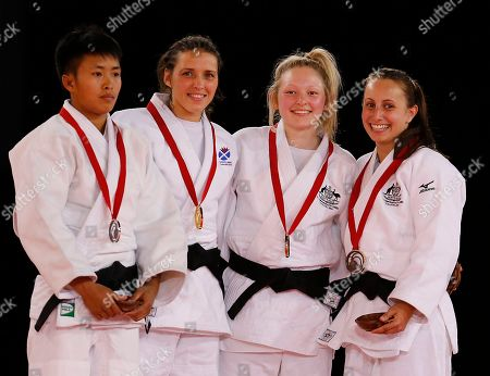 Stock Photo of Winner Scotland's Kimberly Renicks, second from right, second placed Shushila Likmabam from India, left, and third placed Chloe Rayner from Australia and Amy Meyer from Australia pose with medals after their women -48kg Judo final bout at the Commonwealth Games 2014 in Glasgow, Scotland
