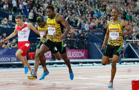 Rasheed Dwyer of Jamaica wins the men's 200m final ahead of teammates Warren Weir, right, and Jason Livermore, left, at Hampden Park Stadium during the Commonwealth Games 2014 in Glasgow, Scotland
