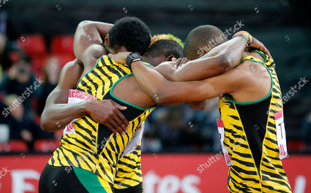 Jamaica's winning sprint team embraces after the 200m final at Hampden Park Stadium during the Commonwealth Games 2014 in Glasgow, Scotland, . Rasheed Dwyer won the race ahead of Warren Weir and Jason Livermore