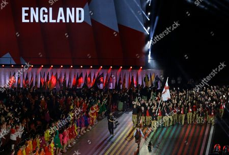 Stock Photo of Nick Matthews England's flag bearer Nick Matthews leads the team into the arena during the opening ceremony for the Commonwealth Games 2014 in Glasgow, Scotland