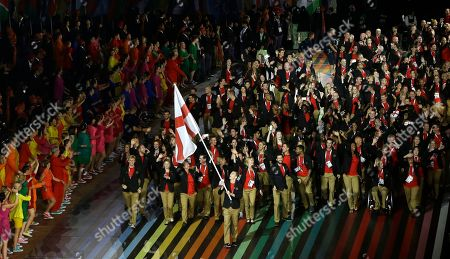 Nick Matthews England's flag bearer Nick Matthews leads the team into the arena during the opening ceremony for the Commonwealth Games 2014 in Glasgow, Scotland