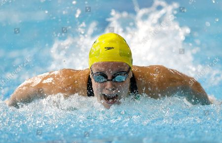 Stock Image of Ellen Gandy of Australia competes in a Women's 100m Butterfly heat at the Tollcross International Swimming Centre during the Commonwealth Games 2014 in Glasgow, Scotland