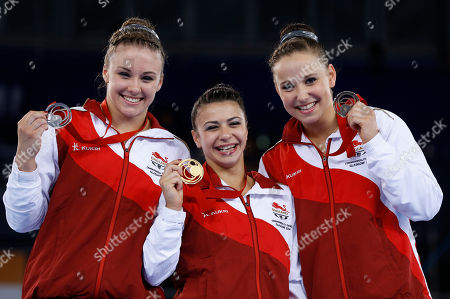 Stock Photo of Ruby Harold with silver, left, Claudia Fragapane with gold, centre, and Hannah Whelan with bronze, right, all of England hold up their medals after the Women's All-Around gymnastics competition at the Scottish Exhibition Conference Centre during the Commonwealth Games 2014 in Glasgow, Scotland