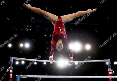 Bronze medal winner Hannah Whelan of England performs on the uneven bars during the Women's All-Around gymnastics competition at the Scottish Exhibition Conference Centre during the Commonwealth Games 2014 in Glasgow, Scotland