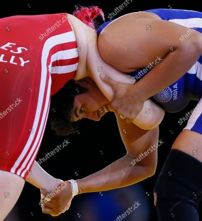 Geetika Jakhar, right, of India pushes over Sarah Connolly of Wales during their women's freestyle 63 kg wrestling bout at the Commonwealth Games Glasgow 2014, in Glasgow, Scotland, Thursday, July, 31, 2014
