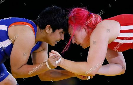 Geetika Jakhar, left, of India grapples with Sarah Connolly of Wales during their women's freestyle 63 kg wrestling bout at the Commonwealth Games Glasgow 2014, in Glasgow, Scotland, Thursday, July, 31, 2014