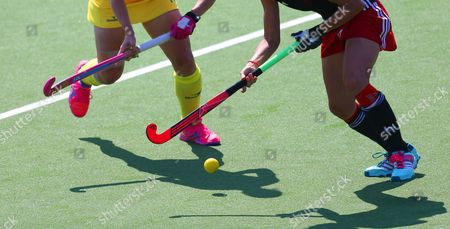 Australia's Edwina Bone, left and Wales Julia Wilkinson, right, clash for the ball during their side's field hockey match at the Commonwealth Games Glasgow 2014, Glasgow National Hockey Centre, Scotland, . The games run till August 3, with 71 countries and 2 territories taking part