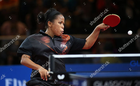 Guyana's Natalie Cummings plays a return to Wales' Charlotte Carey in the Women's Table Tennis singles at the Commonwealth Games Glasgow 2014, Glasgow, Scotland