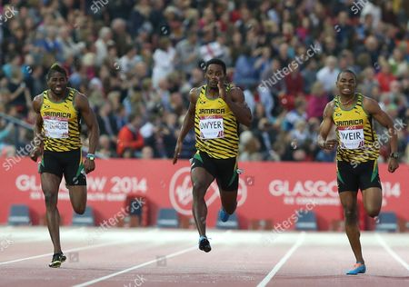 Rasheed Dwyer, centre of Jamaica, leads home a Jamaica 1, 2, 3, with Warren Weir, right, who placed second and Jason Livermore place 3rd in the men's 200 meter race at Hampden Park Stadium during the Commonwealth Games 2014 in Glasgow, Scotland, . Dwyer won the gold medal winning the race
