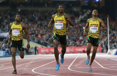 Rasheed Dwyer, centre of Jamaica, reacts after winning the men's 200 meter final race and leads home a Jamaica 1, 2, 3, with Warren Weir, right, who placed second and Jason Livermore both of Jamaica who place third at Hampden Park Stadium during the Commonwealth Games 2014 in Glasgow, Scotland