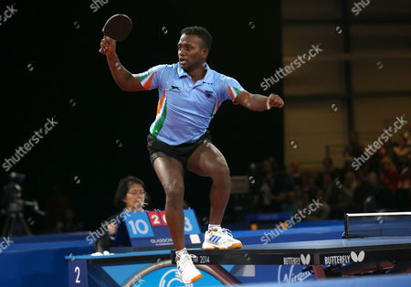 India's Anthony Arputharaj celebrates after defeating Singapore's Jian Zhan and Zi Yang in the Men's Doubles Table tennis Semi-final at Hampden Park Stadium during the Commonwealth Games 2014 in Glasgow, Scotland