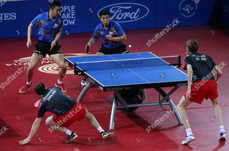 Singapore's Jian Zhan, right, and Zi Yang in action against England's Liam Pitchford, right, and Paul Drinksall in the Men's Doubles for bronze medal match, during the Commonwealth Games 2014 in Glasgow, Scotland