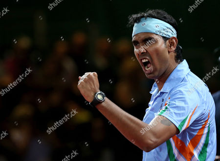 India's Sharat Kamal Achanta celebrates after defeating Singapore's Jian Zhan and Zi Yang in the Men's Doubles Table tennis semi-final at Hampden Park Stadium during the Commonwealth Games 2014 in Glasgow, Scotland