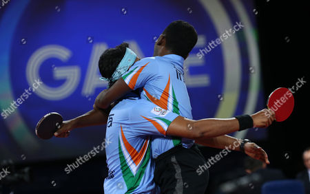 India's Anthony Arputharaj, right, and Sharat Kamal Achanta celebrate after defeating Singapore's Jian Zhan and Zi Yang in the Men's Doubles Table tennis Semi-final at Hampden Park Stadium during the Commonwealth Games 2014 in Glasgow, Scotland