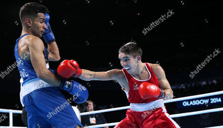 Michael Conlan, right, of Northern Ireland trades punches with Qais Ashfaq of England during their men's gold medal bantamweight boxing bout at the Commonwealth Games Glasgow 2014, in Glasgow, Scotland, Saturday, Aug., 2, 2014