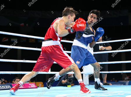 Michael Conlan, left, of Northern Ireland trades punches with Qais Ashfaq of England during their men's gold medal bantamweight boxing bout at the Commonwealth Games Glasgow 2014, in Glasgow, Scotland, Saturday, Aug., 2, 2014