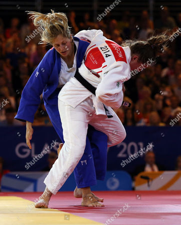 Stock Picture of Wales' Natalie Powell, right, and England's Gemma Gibbons fight during the Women's -78kg judo gold medal bout at the Commonwealth Games 2014 in Glasgow, Scotland