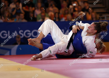 STR Wales' Natalie Powell, left, and England's Gemma Gibbons fight during the Women's -78kg judo gold medal bout at the Commonwealth Games 2014 in Glasgow, Scotland
