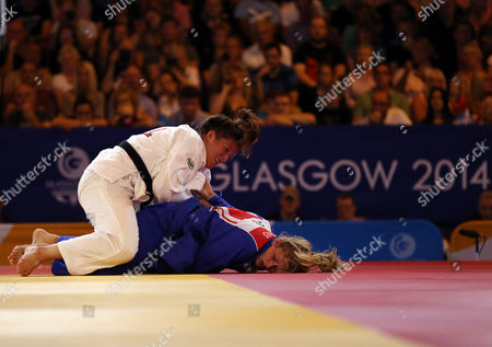 Stock Photo of Wales' Natalie Powell, left, and England's Gemma Gibbons fight during the Women's -78kg judo gold medal bout at the Commonwealth Games 2014 in Glasgow, Scotland