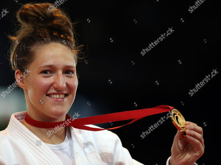 Natalie Powell Wales' Natalie Powell poses with her Gold medal after winning against England's Gemma gibbons in the Women's -78kg judo gold medal bout at the Commonwealth Games 2014 in Glasgow, Scotland