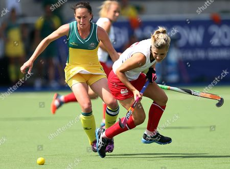 Australia's Madonna Bylth, left, vies for the ball with England's Georgie Twigg, right, during the Commonwealth Games Glasgow 2014,Glasgow National Hockey Centre, Scotland
