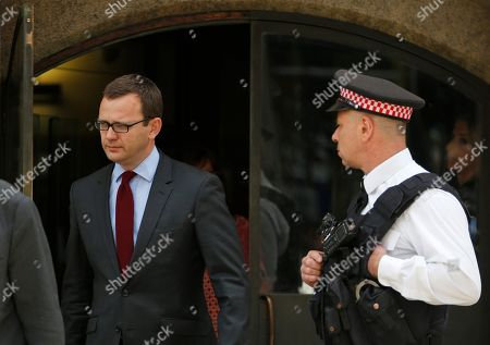 Stock Photo of Andy Coulson Andy Coulson, left, former News of the World editor and the former spin doctor of British Prime Minister David Cameron, leaves the Central Criminal Court in London, . Coulson was convicted of phone hacking Tuesday, but fellow editor Rebekah Brooks was acquitted after a monthslong trial centering on illegal activity at the heart of Rupert Murdoch's newspaper empire. A judge on Wednesday dismissed the jury at Britain's phone-hacking trial after it failed to reach a verdict on two final counts, having convicted him of hacking a day earlier. Judge John Saunders ended the trial after jurors said they could not agree whether Coulson and ex-royal editor Clive Goodman were guilty of paying police officers for royal phone directories. Prosecutors said they would announce next week whether they would seek a retrial
