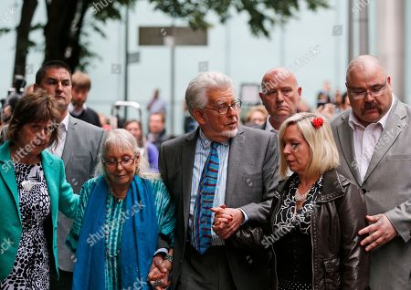 Rolf Harris, Bindi Harris, Alwen Harris Veteran entertainer Rolf Harris, center, accompanied by his wife Alwen, second left, daughter Bindi, second right, and niece Jenny, left, leave the Southwark Crown Court in London, . A jury Monday found Australian-born Harris guilty of 12 counts of indecent assault.The 84-year-old was convicted of indecent assault on four victims aged 19 or under between 1968 and 1986. Harris was a prominent British broadcaster for decades and once performed with the Beatles. He had denied the charges