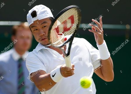 Jimmy Wang of Chinese Taipei plays a return to Sam Querrey of U.S. during their men's singles match at the All England Lawn Tennis Championships in Wimbledon, London