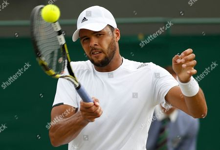 Jo-Wilfried Tsonga of France plays a return to Jimmy Wang of Chinese Taipei during their men's singles match at the All England Lawn Tennis Championships in Wimbledon, London