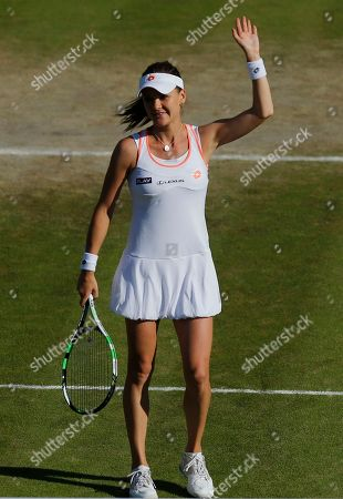 Agnieszka Radwanska of Poland waves to the crowd and celebrates after defeating Michelle Larcher De Brito of Portugal in their women's singles match at the All England Lawn Tennis Championships in Wimbledon, London