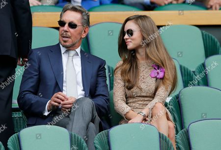 Larry Ellison, left, and Nikita Kahn take their seats in the Royal Box prior to the men's singles final between Roger Federer of Switzerland and Novak Djokovic of Serbia on centre court at the All England Lawn Tennis Championships in Wimbledon, London