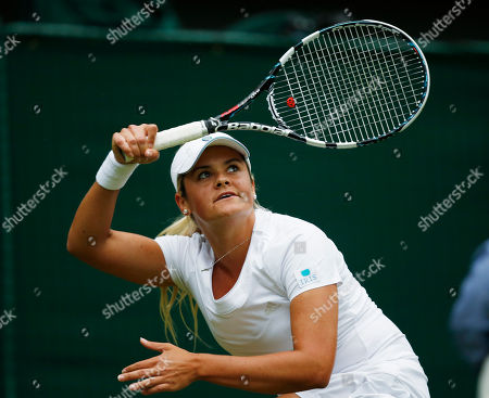 Aleksandra Wozniak of Canada plays a return to Domimika Cibulkova of Slovakia during their first round match at the All England Lawn Tennis Championships in Wimbledon, London