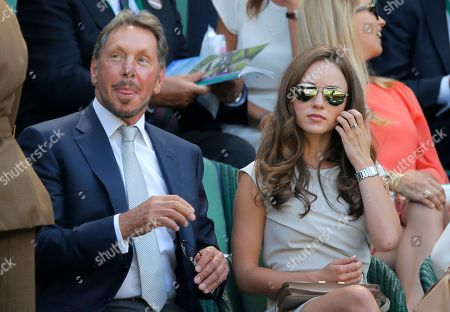 Larry Ellison and Nikita Kahn sit in the Royal Box on centre court prior to the men's singles semifinal match between Novak Djokovic of Serbia and Grigor Dimitrov of Bulgaria at the All England Lawn Tennis Championships in Wimbledon, London