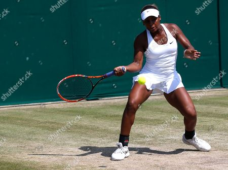 Stock Image of Tornado Alicia Black of the U.S plays a return to Jelena Ostapenko of Latvia during their girls' singles quarterfinal match at the All England Lawn Tennis Championships in Wimbledon, London